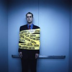 Businessman Wrapped in Caution Tape 2002